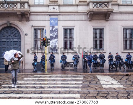MILAN, ITALY - MAY 1 : demonstration held in Milan May 1, 2015. Police during protest against Milan expo to be held in 2015, event important worldwide.  - stock photo