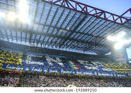 MILAN, ITALY-MAY 04, 2014: FC Internazionale fans choreography at the San Siro stadium, during the Italian serie A soccer match, AC Milan vs FC Internazionale, in Milan. - stock photo
