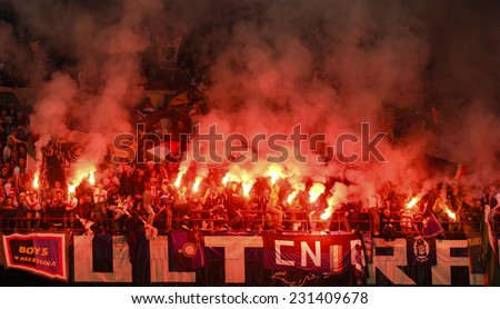 MILAN, ITALY-MAY 18, 2008: FC Internazionale fans light  smoke bombs at the san siro stadium, in Milan. - stock photo