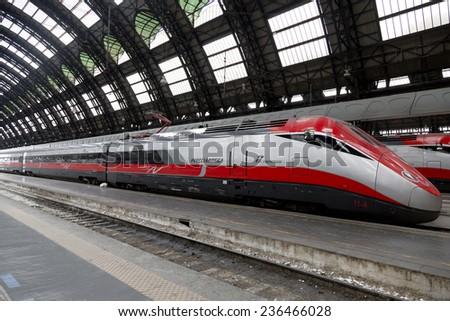 MILAN, ITALY - MAY 7, 2014: High-speed Eurostar train at the railway station in Milan - stock photo