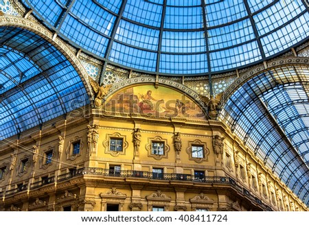Milan, Italy - May 8, 2014: Interiors of Galleria Vittorio Emanuele II. Built in 1875 this gallery is one of the most popular shopping areas in Milan. - stock photo