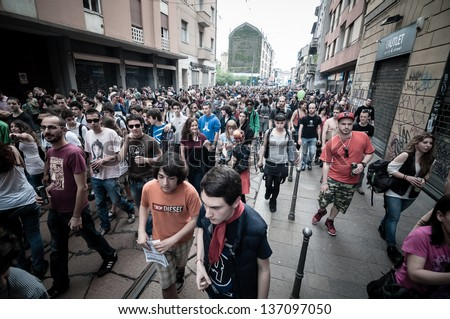 MILAN, ITALY - MAY 1: labor day held in Milan on May 1, 2013. Every year thousands of people taking to the streets to celebrate labor day and to protest against italian austerity