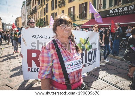 MILAN, ITALY - MAY 1: labor day held in Milan on May 1, 2014. Every year thousands of people taking to the streets to celebrate labor day and to protest against italian austerity