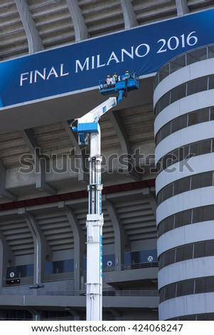 MILAN, ITALY - MAY 21, 2016: Men at work to decorate the San Siro stadium before the 2016 UEFA Champions League final game between Real Madrid and Atletico