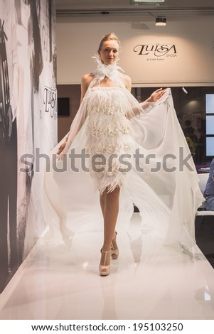 MILAN, ITALY - MAY 23: Model poses at Si' Sposaitalia, ultimate exhibition for bridal and formal wear industry on MAY 23, 2014 in Milan.