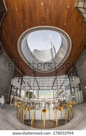 MILAN, ITALY, May 12, 2015: New area of Porta Garibaldi. Skyscraper view Unicredit from the hallway entrance to the Piazza Aulenti - stock photo