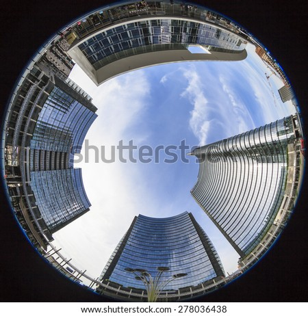 MILAN, ITALY, May 12, 2015: New area of Porta Garibaldi. View of Piazza Aulenti through a fisheye lens - stock photo