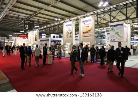 MILAN, ITALY - MAY 20: People at food productions exhibition stands at Tuttofood, Milano World Food Exhibition May 20, 2013 in Milan, Italy. - stock photo