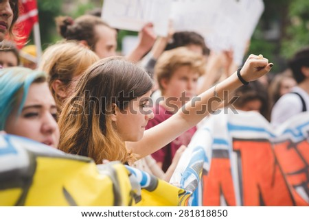 MILAN, ITALY - MAY 05: Students manifestation held in Milan on May, 5 2015. Students and teachers took to the streets to protest against new laws on education by minister Stefania Giannini - stock photo