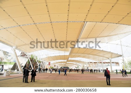 MILAN, ITALY-MAY 04, 2015: the main visitors footpath way with the architectural  roof construction of the EXPO 2015, in Milan. - stock photo