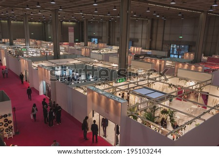 MILAN, ITALY - MAY 23: Top view of booths and people at Si' Sposaitalia, ultimate exhibition for bridal and formal wear industry on MAY 23, 2014 in Milan.