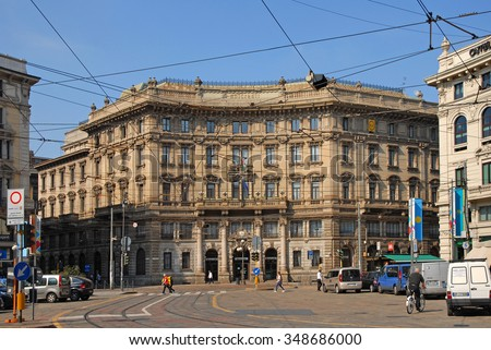 MILAN, ITALY MAY 18, 2015:  tourists and city life in Milan downtown Cordusio square. The city  hosted  the World   Expo 2015. - stock photo
