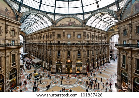 MILAN, ITALY - MAY 2: Unique view of Galleria Vittorio Emanuele II seen from above in Milan on May 2, 2012. Built in 1875 this gallery is one of the most popular shopping areas in Milan. - stock photo