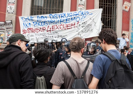 MILAN, ITALY - MAY 7: University students during a protest march in Milan MAY 7, 2013. University students march in the streets to protest against  the evacuation of their occupied bookstore by police