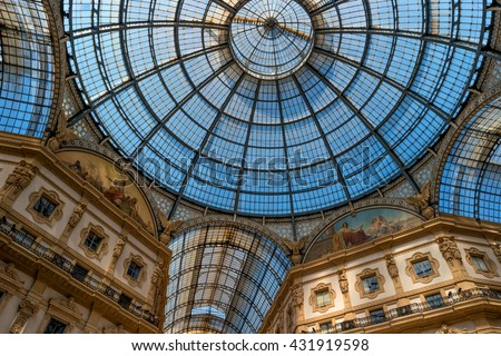 Milan, Italy - May 25, 2016: view of the glass roof and upper floors Galleria Vittorio Emanuele II. The gallery was designed by the architect Giuseppe Mengoni in the 1865-1877 biennium.