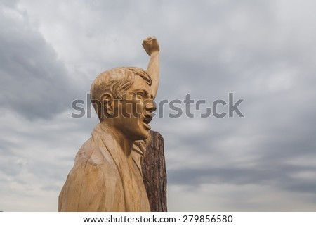 MILAN, ITALY - MAY 19: Wooden statue on the top of South Tytol pavilion at Expo, universal exposition on the theme of food on MAY 19, 2015 in Milan.