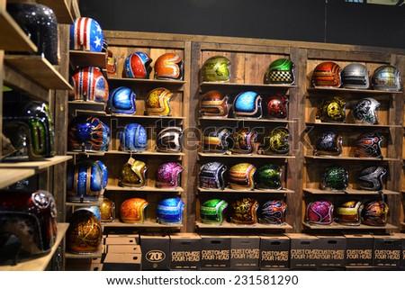MILAN, ITALY - NOV 8: Colored helmets  at EICMA, 72 th International Motorcycle Exhibition November 8, 2014 in Milan, Italy. - stock photo
