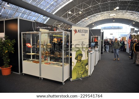 MILAN, ITALY - NOV 1: Exhibitor sitting in his stand at Militalia, exhibition dedicated to militaria collectors and military associations on November 1, 2014 in Milan. - stock photo
