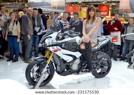 MILAN, ITALY - NOV 8: Model at stand bmw  at EICMA, 72 th International Motorcycle Exhibition November 8, 2014 in Milan, Italy. - stock photo