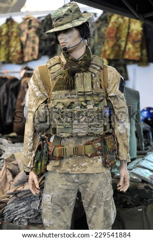 MILAN, ITALY - NOV 1:Uniform,  Exhibitor sitting in his stand at Militalia, exhibition dedicated to militaria collectors and military associations on November 1, 2014 in Milan.
