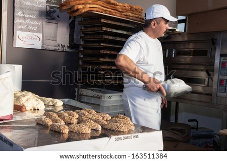 MILAN, ITALY - NOVEMBER 16: Baker prepares bread at Golosaria, important event dedicated to culture and tradition of quality food and wine on NOVEMBER 16, 2013 in Milan.
