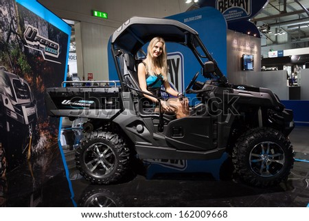 MILAN, ITALY - NOVEMBER 5: Beautiful model on an off-road vehicle at EICMA, international motorcycle exhibition on NOVEMBER 5, 2013 in Milan.