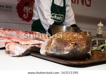 MILAN, ITALY - NOVEMBER 16: Big fish head during preparation at Golosaria, important event dedicated to culture and tradition of quality food and wine on NOVEMBER 16, 2013 in Milan. - stock photo
