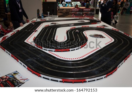MILAN, ITALY - NOVEMBER 22: Car track at G! come giocare, trade fair dedicated to games, toys and children on NOVEMBER 22, 2013 in Milan.