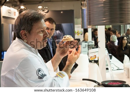 MILAN, ITALY - NOVEMBER 18: Chef explainss his creation at Golosaria, important event dedicated to culture and tradition of quality food and wine on NOVEMBER 18, 2013 in Milan. - stock photo
