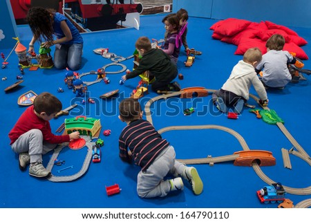 MILAN, ITALY - NOVEMBER 22: Children play at G! come giocare, trade fair dedicated to games, toys and children on NOVEMBER 22, 2013 in Milan.