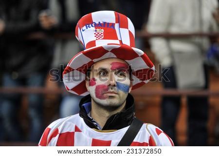 MILAN, ITALY-NOVEMBER 16, 2014:croatian fan wearing national colors, during the international soccer match Italy vs Croatia, in Milan. - stock photo
