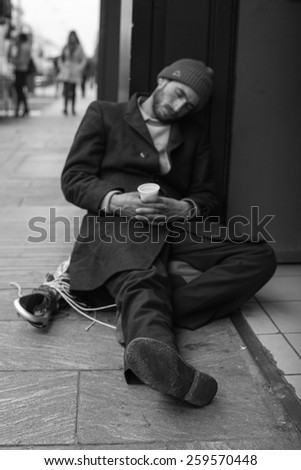 MILAN, ITALY - NOVEMBER, 24: Homeless sleeping in the floor of the street on November 24, 2014