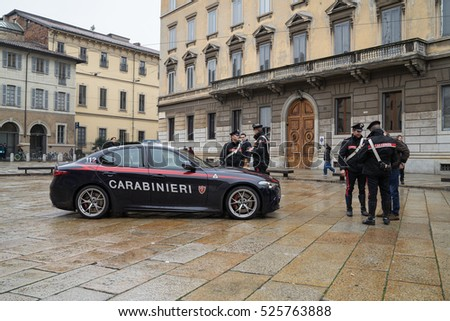 MILAN, ITALY - NOVEMBER 24, 2016: Italian carabiniers and their car on the square of Piazza di Santa Maria delle Grazie. The Carabinieri is the national gendarmerie of Italy.