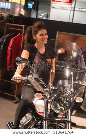 MILAN, ITALY - NOVEMBER 8: Model poses at EICMA, international motorcycle exhibition on NOVEMBER 8, 2016 in Milan.