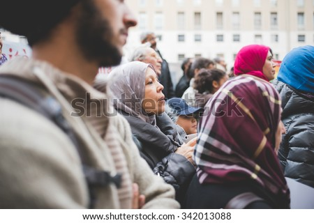MILAN, ITALY - NOVEMBER 21: muslims manifestation against terrorism in Milan on November, 21 2015. Muslims Protest against terrorist attacks happened in Paris on November 13, 2015. - stock photo