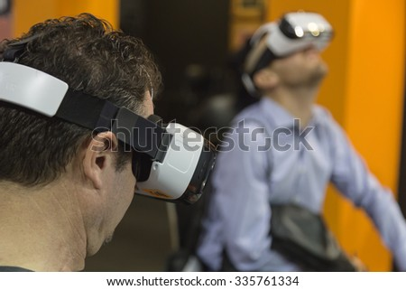 MILAN, ITALY - NOVEMBER 5: People try virtual reality headset at Sicurezza, leading international event in the sector of security on NOVEMBER 5, 2015 in Milan.