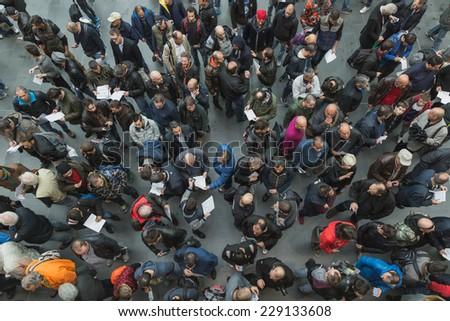 MILAN, ITALY - NOVEMBER 5: People visit EICMA, international motorcycle exhibition on NOVEMBER 5, 2014 in Milan. - stock photo