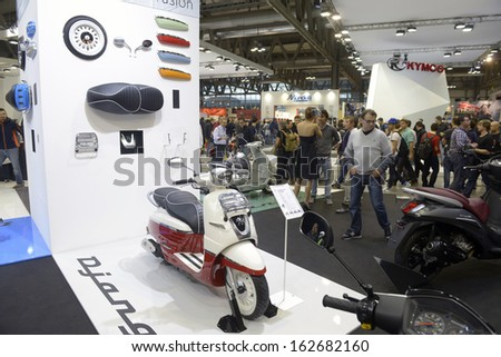 MILAN, ITALY - NOVEMBER 8: People visit motorcycles and scooters exhibition EICMA, 71st International Motorcycle Exhibition on November 8, 2013 in Milan, Italy.