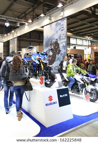 MILAN, ITALY - NOVEMBER 7: People visit Suzuki products exhibition area during EICMA, 71st International Motorcycle Exhibition on November 7, 2013 in Milan, Italy.
