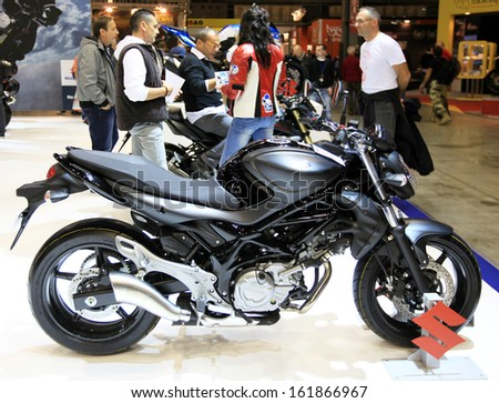 MILAN, ITALY - NOVEMBER 7: Profile of a brand new Suzuki motorcycle in exhibition at EICMA, 71st International Motorcycle Exhibition on November 7, 2013 in Milan, Italy.