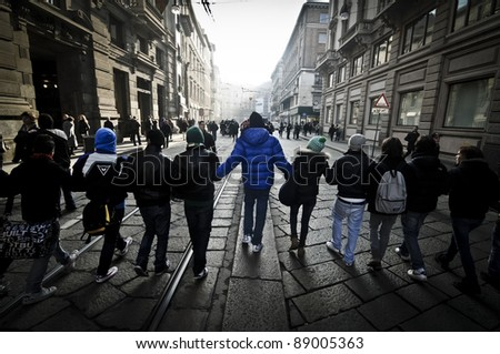 MILAN, ITALY - NOVEMBER 17: protest against economic crisis in Milan november 17, 2011. Students manifests in the streets against the economic crisis and against the banks
