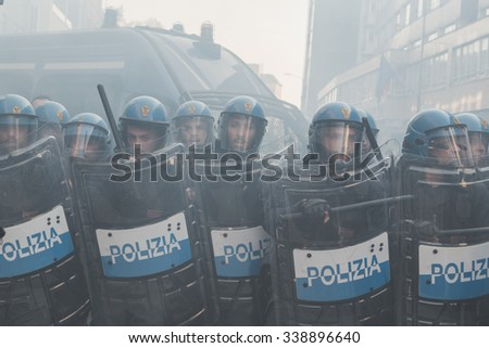 MILAN, ITALY - NOVEMBER 13: Riot police confronting the students during a march in the city streets to protest agaist the public school management on NOVEMBER 13, 2015 in Milan. - stock photo