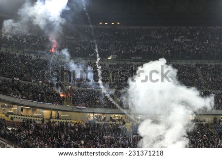 MILAN, ITALY-NOVEMBER 16, 2014: smoke bombs thrown by croatian fans into the san siro soccer field, during the international soccer match Italy vs Croatia, in Milan. - stock photo