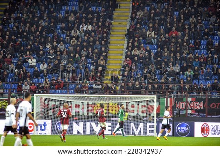MILAN, ITALY-NOVEMBER 02, 2014: soccer stadium fans and soccer players in action during the italian serie A soccer match AC Milan vs Palermo, at the san siro stadium, in Milan.
