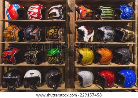 MILAN, ITALY - NOVEMBER 5: Stylish helmets on display at EICMA, international motorcycle exhibition on NOVEMBER 5, 2014 in Milan. - stock photo