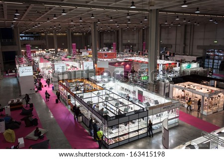 MILAN, ITALY - NOVEMBER 15: Top view of booths and people at Chibimart 2013, exhibition devoted to costume jewellery, fashion accessories and ethnic products on NOVEMBER 15, 2013 in Milan. - stock photo