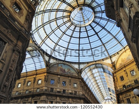 MILAN, ITALY - NOVEMBER 2: Unique view of Galleria Vittorio Emanuele II in Milan on November 2, 2012. Built in 1875 this gallery is one of the most popular shopping areas in Milan. - stock photo