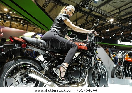 moto bike. milan, italy-november 08, 2017: young model girl poses on a kavasaki moto bike