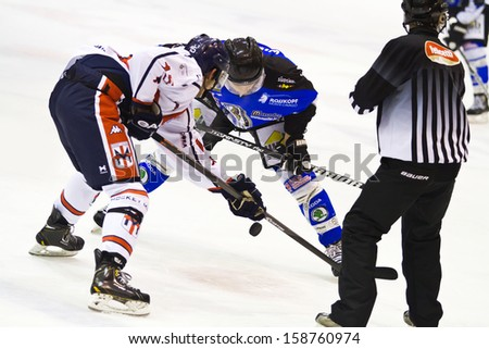 MILAN, ITALY - OCT 10: Braito of HC Vipiteno and Edoardo Caletti of HC Milano during a game at Agora  Arena on October 10, 2013, in Milan, Italy. - stock photo