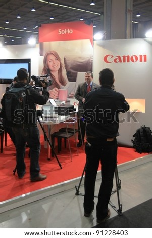 MILAN, ITALY - OCT. 19: Interview at Canon technologies stands at SMAU, international fair of business intelligence and information technology October 19, 2011 in Milan, Italy.